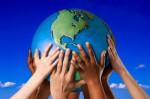 Many hands on a globe