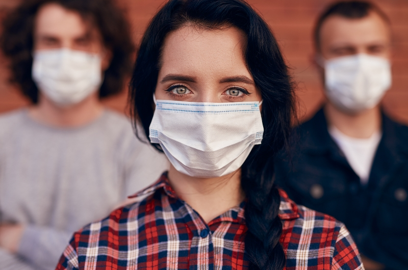 pandemic - one year later, people wearing masks